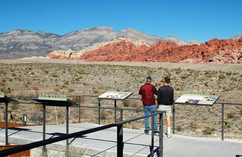 two men enjoying views from red rock canyon visitor center