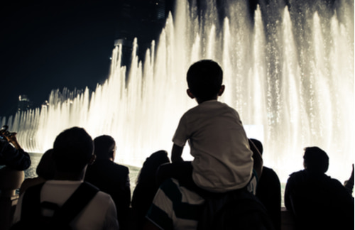people viewing the bellagio fountain at night