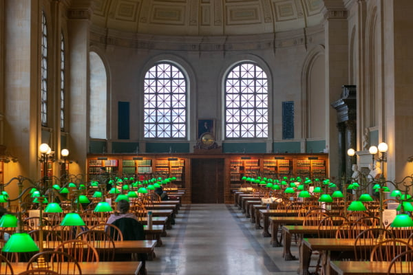 the large reading room in the Boston Public Library