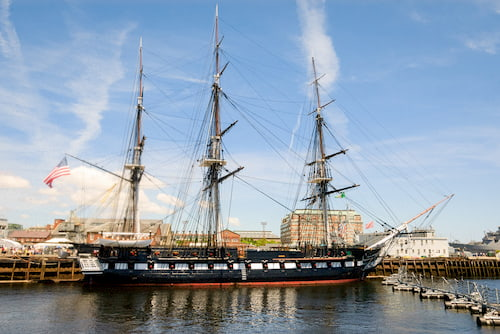 the uss constitution sits on the water
