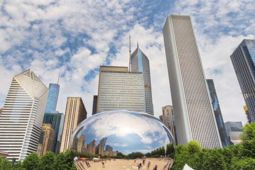 A view of cloud gate with the chicago skyline in the background