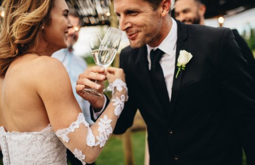 a happy couple toasts champagne on their wedding day