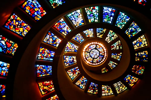 stain glass windows spiral on a wall in the Dallas Chapel