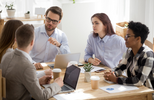 A small business meets with potential clients