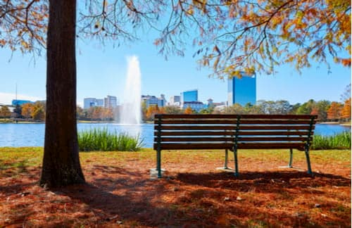Bench and lake in Hermann Park