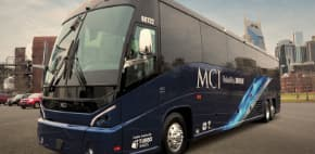 an MCI j4500 charter bus parked on pavement