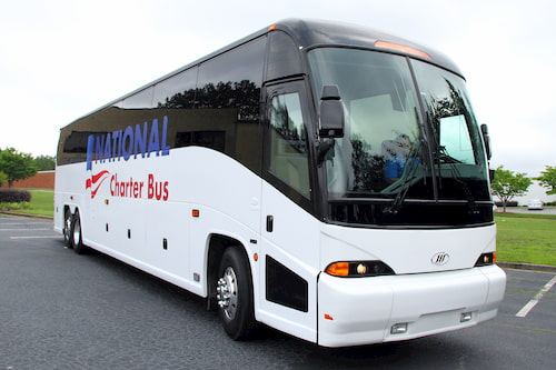 a white charter bus with the logo for national charter bus on the side