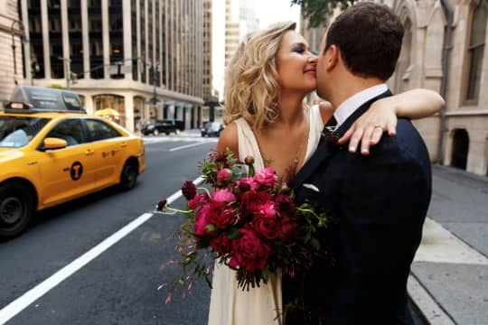 bride and groom embracing on the chicago streets