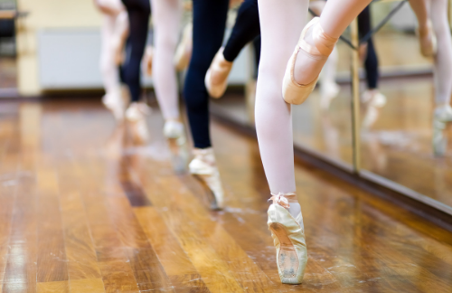 juilliard ballerinas balance on their toes in front a mirror