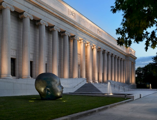 a statue of a head outside of the museum of fine arts