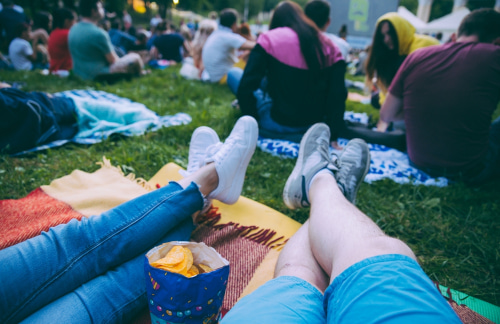 people gather for a movie screening event at Lake Eola Park