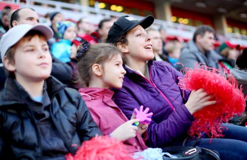 mother and children cheer on the Red Sox from the stands