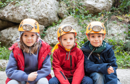 three children in spelunking gear get ready to explore the Natural Bridge Caverns
