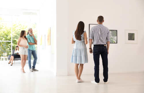 families and couples admire art in a San Antonio gallery
