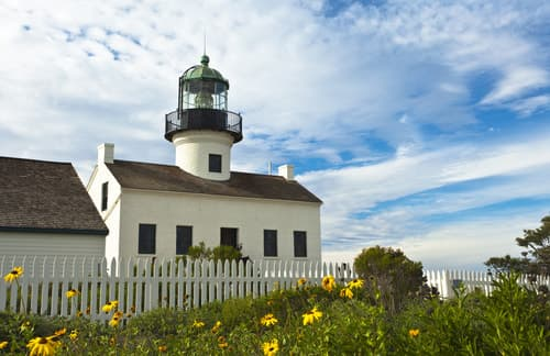 old point loma lighthouse surrounded by flowers