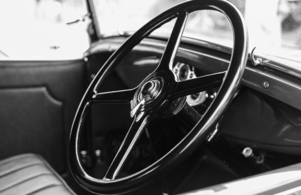 An old steering wheel of a 1940s-era cruiser vehicle