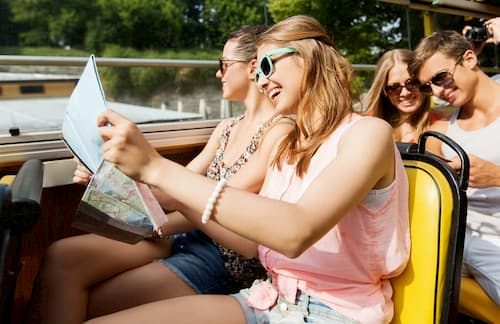 Women looking at maps on tour bus