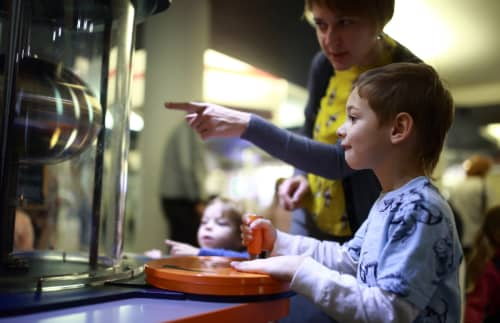 A child and teacher at the Perot Museum of Science
