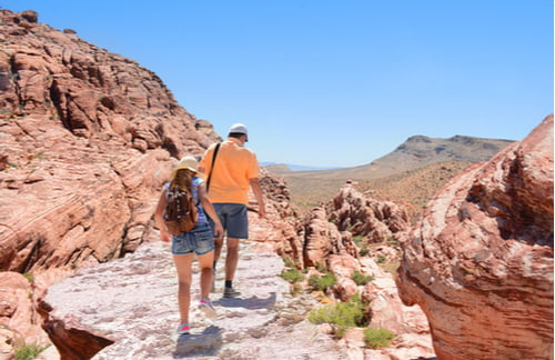 father and daughter hiking red rock canyon