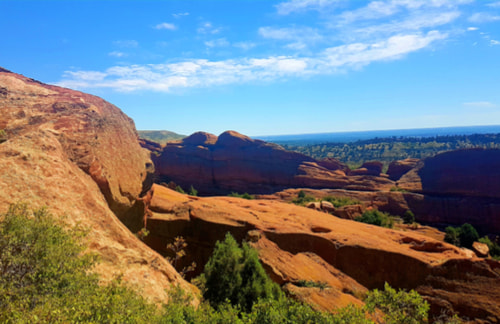 Red Rocks Amphitheater and Park during the day with an overlooking view of the rock formations