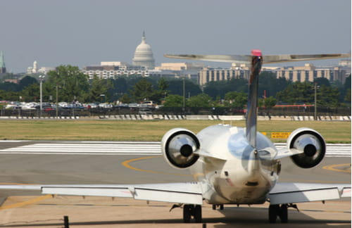 view of the us capitol building from ronald reagan airport washington dc