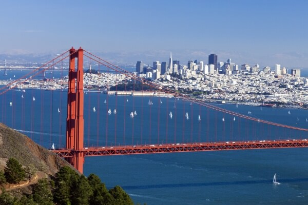 view of the golden gate bridge with an aerial view of the bay and San Francisco