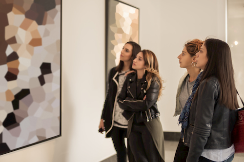 patrons admire a painting at the denver art museum