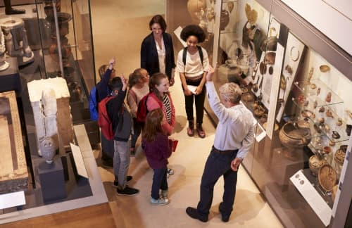 Students touring museum with a guide
