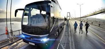 a blue temsa charter bus on a bridge