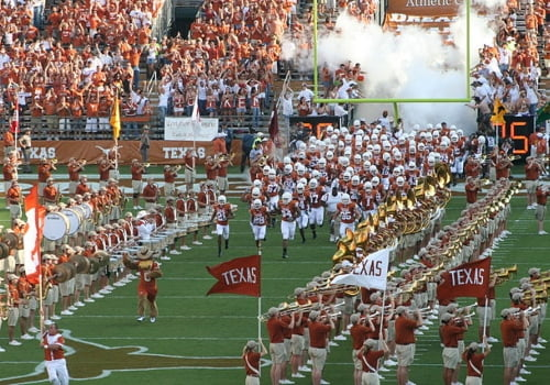 Texas Longhorns football team entering stadium