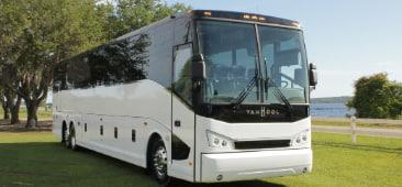 a white van hool charter bus