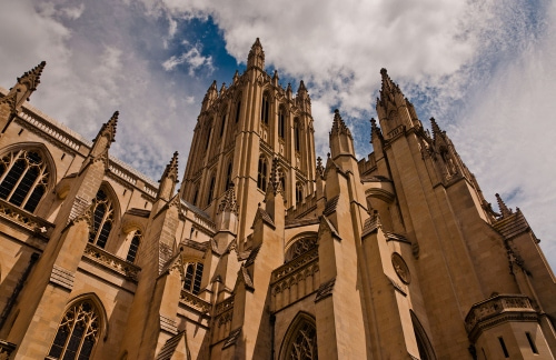 The exterior facade of the Washington National Cathedral on a cloudy day